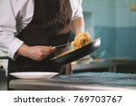 chef serves spaghetti on the... | Shutterstock . vector #769703767