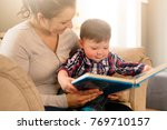 a mother reading book with her... | Shutterstock . vector #769710157