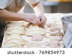 cook is shaping meat pies by... | Shutterstock . vector #769854973