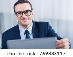 online meeting. pensive... | Shutterstock . vector #769888117