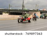 motorcyclists in a cape against ... | Shutterstock . vector #769897363