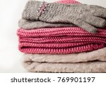 woolen warm things on old wood... | Shutterstock . vector #769901197