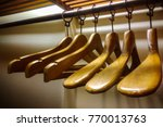 wood hanger in wardrobe | Shutterstock . vector #770013763
