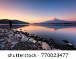 silhouette tourists stand see... | Shutterstock . vector #770023477