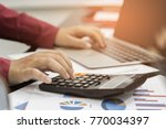 a business woman analyzing... | Shutterstock . vector #770034397