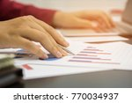 a business woman analyzing... | Shutterstock . vector #770034937