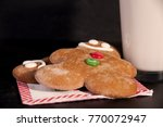 gingerbread man and glass of... | Shutterstock . vector #770072947