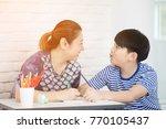 asian boy with mother teaching... | Shutterstock . vector #770105437