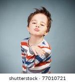 portrait of grimacing little... | Shutterstock . vector #77010721