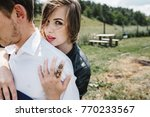 Small photo of A beautiful couple in love walks along the lake along the shore with green grass