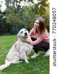 image of girl with dog on lawn... | Shutterstock . vector #770248057