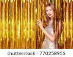 beautiful woman celebrating new ... | Shutterstock . vector #770258953