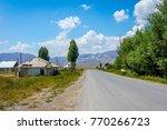 local road thur kyrgyz village... | Shutterstock . vector #770266723