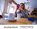 smartphone addicted girl using... | Shutterstock . vector #770277973