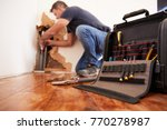 middle aged man repairing burst ... | Shutterstock . vector #770278987