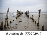 Old Fishing Dock In The Sea