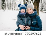 happy young mother with son... | Shutterstock . vector #770297623