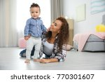 cute baby and young mother at... | Shutterstock . vector #770301607
