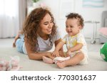cute baby and mother playing on ... | Shutterstock . vector #770301637