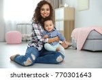 cute baby and mother sitting on ... | Shutterstock . vector #770301643