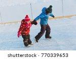 little boy and girl skating... | Shutterstock . vector #770339653