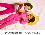children with shocked faces... | Shutterstock . vector #770374153