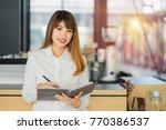 asian entrepreneur standing... | Shutterstock . vector #770386537