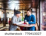 senior father and his young son ...   Shutterstock . vector #770413327