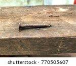 Closeup Nail Rusty On Old Wood...