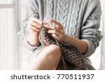 women's hands knit. the girl... | Shutterstock . vector #770511937