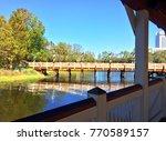 bridge over a lake on a sunny... | Shutterstock . vector #770589157
