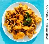raw wild chanterelles mushrooms ...   Shutterstock . vector #770593777