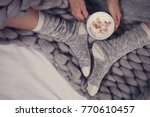 female feet wearing cozy warm... | Shutterstock . vector #770610457