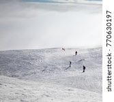 skiers and snowboarders... | Shutterstock . vector #770630197