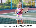 child playing tennis on outdoor ... | Shutterstock . vector #770633773