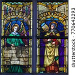 Small photo of ANTWERP, BELGIUM - APRIL 30, 2017: Stained Glass window in the Church of Saint Andrew in Antwerp, Belgium, depicting Saint Teresa of Avila