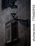 Small photo of Gas lamp post and old shuttered window in alleyway in Winterthur Switzerland