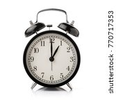 black alarm clock isolated on... | Shutterstock . vector #770717353