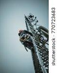 telecom worker climbing antenna ... | Shutterstock . vector #770723683