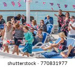 Small photo of Near IJMuiden, The Netherlands; 23rd July 2015; Three Women Dancing at Deck Party Aboard P&O Cruise Ship Oriana. People in Background. Many Have Union Jack Flags.