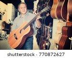 adult glad guitarist is... | Shutterstock . vector #770872627
