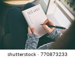 the woman is writing goals for... | Shutterstock . vector #770873233