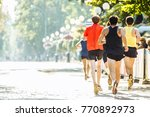 a team of running marathon... | Shutterstock . vector #770892973