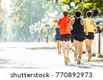 a team of running marathon... | Shutterstock . vector #770892973