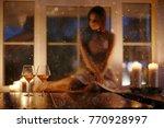 girl adult evening candles... | Shutterstock . vector #770928997