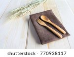 wooden spoon and fork on wooden ... | Shutterstock . vector #770938117