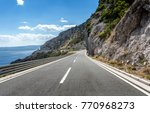 asphalt road to the sea.... | Shutterstock . vector #770968273
