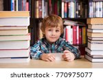 preschooler little boy reading... | Shutterstock . vector #770975077