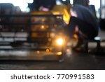 bokeh of worker whose welding... | Shutterstock . vector #770991583