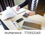 business man uses a calculator... | Shutterstock . vector #771012163